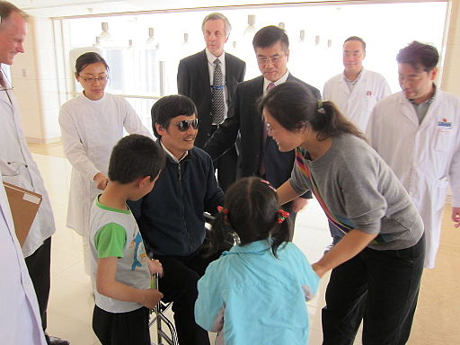 Chen Guangcheng with his family at a hospital in Beijing, China, on May 1, 2012. U.S. Ambassador to China Gary Locke, James Brown, and Regional Medical Officer Wayne Quillin are also pictured. [State Department photo/ Public Domain]