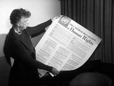 (Eleanor Roosevelt in 1948 with the Universal Declaration of Human Rights/Public Domain)